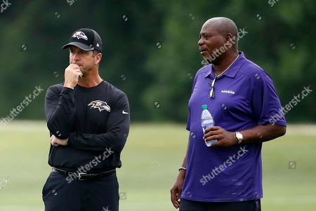 John Harbaugh, Ozzie Newsome Baltimore Ravens head coach John Harbaugh, left, and general manager and executive vice president Ozzie Newsome watch an NFL football training camp practice in Owings Mills, Md
