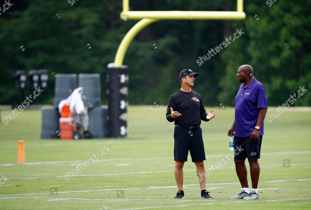 John Harbaugh, Ozzie Newsome Baltimore Ravens head coach John Harbaugh, left, speaks with general manager and executive vice president Ozzie Newsome during an NFL football training camp practice in Owings Mills, Md