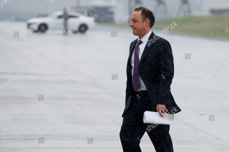 White House Chief of Staff Reince Priebus walks to boards Air Force One at Andrews Air Force Base, Md., to travel with President Donald Trump to Brentwood, N.Y. for a speech to law enforcement officials on the gang MS-13