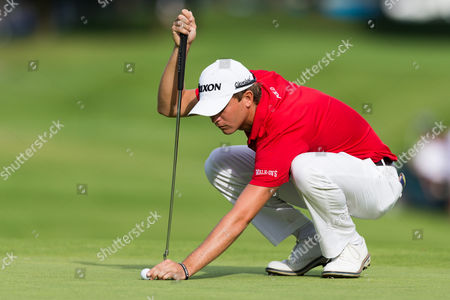 Stock Image of Smylie Kaufman (USA) places ball on the green during the second round of the RBC Canadian Open at Glen Abbey Golf Club in Oakville, Ontario, Canada