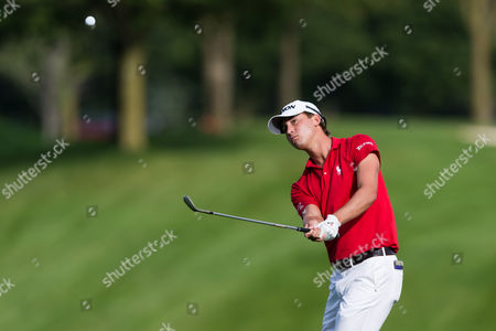 Stock Photo of Smylie Kaufman (USA) chips on to the green during the second round of the RBC Canadian Open at Glen Abbey Golf Club in Oakville, Ontario, Canada