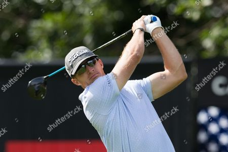 Jason Bohn (USA) tees off at the tenth hole during the second round of the RBC Canadian Open at Glen Abbey Golf Club in Oakville, Ontario, Canada