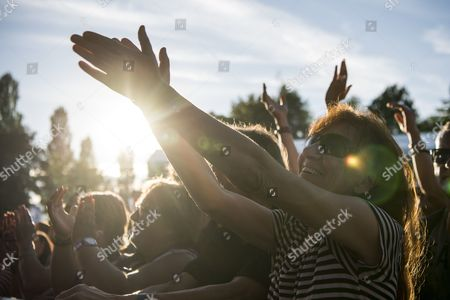 Festival-goers watch the concert of Israeli singer Asaf Avidan on the main stage during the Estivale Open Air, in Estavayer-le-Lac, Switzerland, 28 July 2017. The music festival runs from 28 July to 01 August.