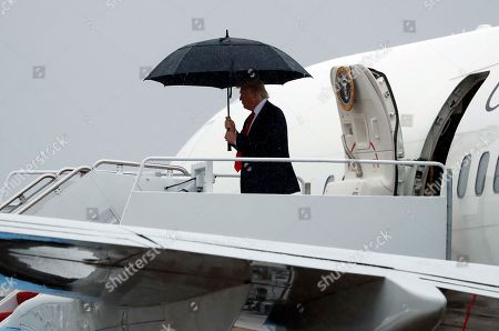 President Donald Trump arrives at Andrews Air Force Base after firing his Chief of Staff Reince Priebus and naming Secretary of Homeland Security John Kelly as his new Chief of Staff, in Andrews Air Force Base, Md
