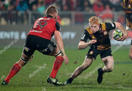 Chiefs Finlay Christie runs at Crusaders Luke Romano during their Super Rugby semifinal in Christchurch, New Zealand