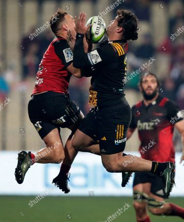 Crusaders Israel Dagg, left, and Chiefs James Lowe compete for the ball during their Super Rugby semifinal in Christchurch, New Zealand
