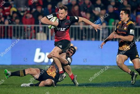 Crusaders Israel Dagg attempts to break the tackle of Chiefs Charlie Ngatai during their Super Rugby semifinal in Christchurch, New Zealand