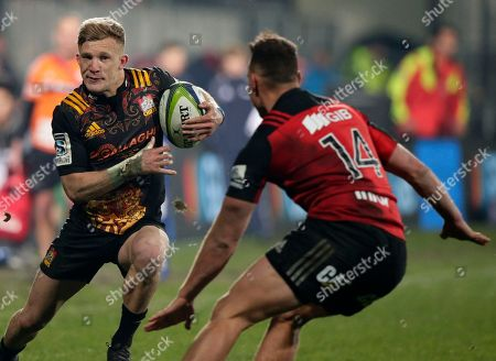 Chiefs Damian McKenzie looks to run past Crusaders Israel Dagg during their Super Rugby semifinal in Christchurch, New Zealand
