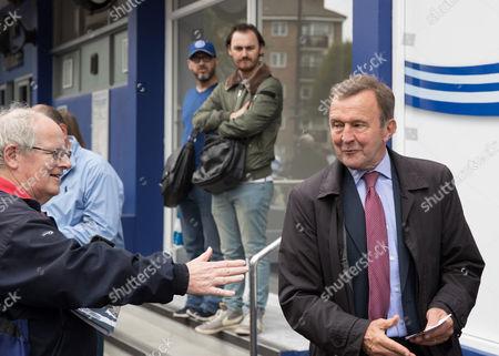 Former QPR player John Hollins  arrives