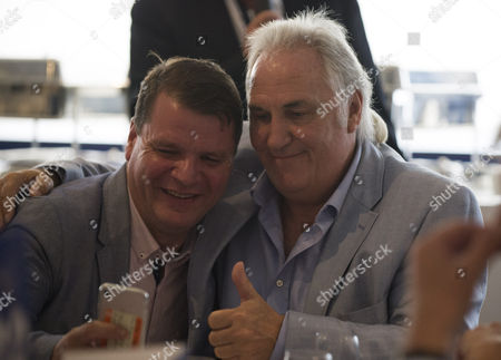 Stock Image of Commercial and marketing... A fan has a selfie with Gerry Francis