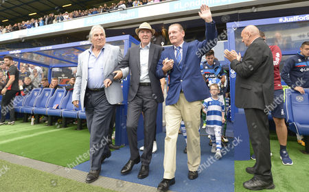 Stan Bowles walks out onto the pitch before the match with Gerry Francis and Don Shanks (r)