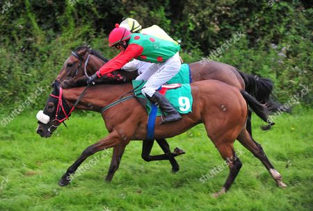 Cahersiveen H&P MR CARSON & Ben Kennedy (near side) win the first division of the maiden race from FREYAS DELIGHT & Tom Kelly (far side).