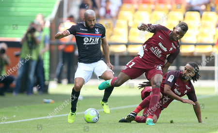 Stock Picture of Andros Townsend of Crystal Palace battles for the ball with Opa Nguette and Benoit Assou-Ekotto Of FC Metz during the pre season friendly between FC Metz and Crystal Palace on 29th July 2017 at The Stade Saint Symphorien, Metz, France.