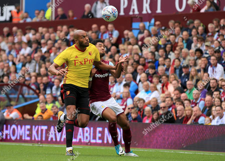 Younes Kaboul of Watford battles with Andre Green of Aston Villa