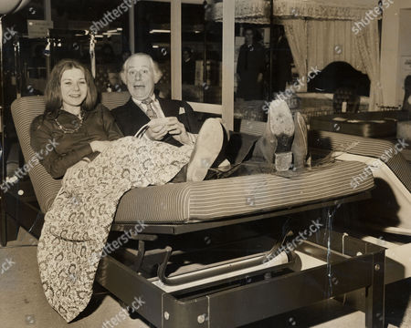 Ideal Home Exhibition 1974. Picture Shows Patrick Cargill Actor And His Co-star Barbra Flynn (staring In The West End Comedy Two And Two Make Sex) Relaxing On An Electrically Adjustable Bed At The Exhibition.