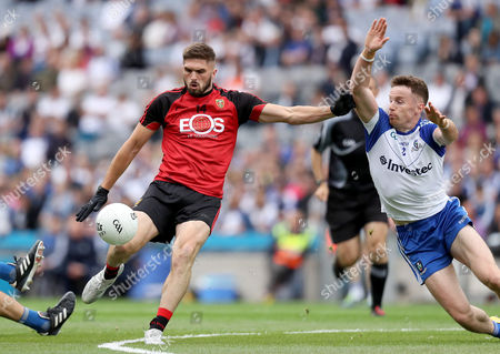 Monaghan vs Down. Down?s Connaire Harrison with Monaghan?s Finatan Kelly