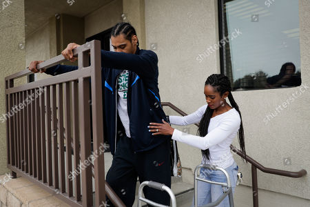 Jamie Nieto, Shevon Stoddart Two-time Olympic jumper Jamie Nieto, left, is helped by his fiancee Shevon Stoddart as he walks down the steps outside the Project Walk paralysis recovery center after his rehab session ahead of the couple's July Wedding, in Claremont, Calif. Nieto was paralyzed from neck down 15 months ago after a spinal cord injury. When he proposed to Stoddart while in a wheelchair, he made a vow that he would walk his bride down the aisle at their wedding. Step by halting step, Nieto made good on his vow to walk wife down the aisle after their wedding and out the door to a waiting limousine. No cane, no walker. Just Nieto holding onto his wife's left hand for support