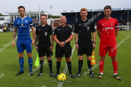 Captains Rob Swaine of Billericay Town (L) and David Mooney of Leyton Orient line up with the match officials during Billericay Town vs Leyton Orient, Friendly Match Football at New Lodge on 29th July 2017