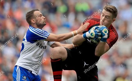 Monaghan vs Down. Monaghan's Darren Freeman with Down goalkeeper Michael Cunningham