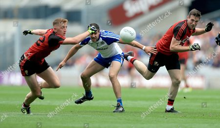 Monaghan vs Down. Monaghan's Drew Wylie with Sean Dornan and Niall Donnelly of Down
