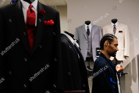 Two-time Olympic jumper Jamie Nieto shops for his tuxedo ahead of his July Wedding, in Pasadena, Calif. Nieto was paralyzed from neck down 15 months ago after a spinal cord injury. When he proposed to Jamaican hurdler Shevon Stoddart while in a wheelchair, he made a vow that he would walk his bride down the aisle at their wedding. Step by halting step, Nieto made good on his vow to walk wife down the aisle after their wedding and out the door to a waiting limousine. No cane, no walker. Just Nieto holding onto his wife's left hand for support