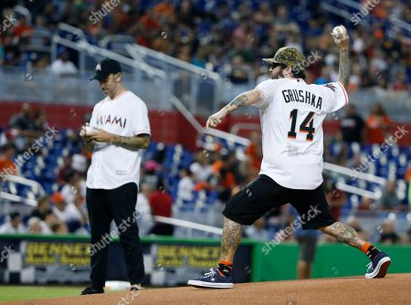 Cyrus Bolooki, New Found Glory, Ian Grushka Ian Grushka (14) and Cyrus Bolooki, left, of the band New Found Glory, throw out ceremonial first pitches before a baseball game between the Miami Marlins and the Cincinnati Reds, in Miami