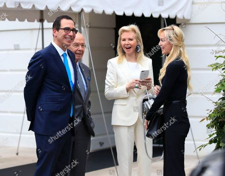 Steven Mnuchin, Louise Linton, Wilbur Ross, Hilary Geary Treasury Secretary Steven Mnuchin, left, and his wife, Scottish actress Louise Linton, right, and Secretary of Commerce Wilbur Ross, second from left, and his wife Hilary Geary, second from right, wait for President Donald Trump on the South Portico of the White House Washington