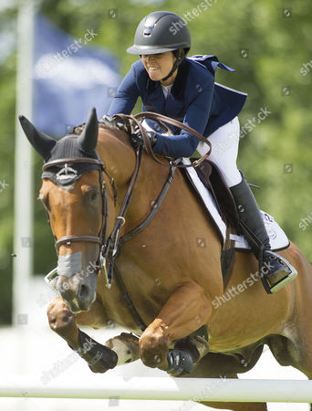 Stock Photo of Reed Kessler (USA) riding Cos I Can in action during The Longines King George V Gold Cup, The Longines Royal International Horse Show, 2017, Hickstead Showground, West Sussex, United Kingdom 30th July 2017