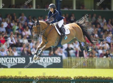 Reed Kessler (USA) riding Cos I Can jumps the water during The Longines King George V Gold Cup, The Longines Royal International Horse Show, 2017, Hickstead Showground, West Sussex, United Kingdom 30th July 2017