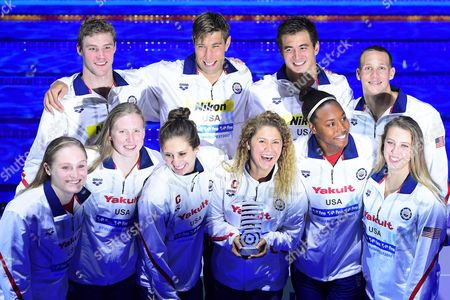 US swimmers (front row, L-R) Kelsi Worrell, Lilly King, Katie Meili, Mallory Comerford, Simone Manuel, and Kathleen Baker; (back row, L-R) Kevin Cordes, Matt Grevers, Nathan Adrian, and Caeleb Remel Dressel pose with their trophy for the best team during the 17th FINA Swimming World Championships in the Duna Arena in Budapest, Hungary, 30 July 2017.