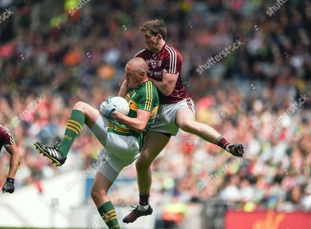 Kerry vs Galway. Kerry's Kieran Donaghy with David Walsh of Galway.