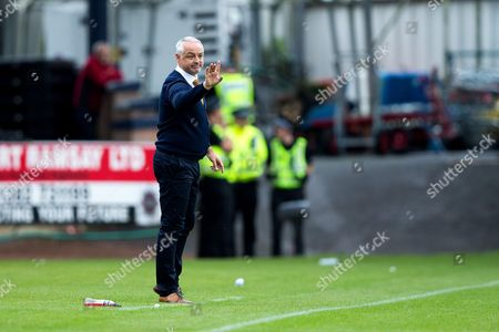 Dundee United manager Ray McKinnon issues instructions from the touchline during the Betfred Scottish Cup group stage match between Dundee and Dundee United at Dens Park, Dundee