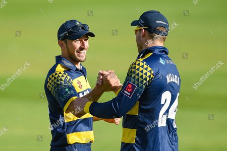 Stock Image of Andrew Salter of Glamorgan celebrates the team win with teammate David Millar of Glamorgan during the NatWest T20 Blast South Group match between Kent County Cricket Club and Glamorgan County Cricket Club at the Spitfire Ground, Canterbury