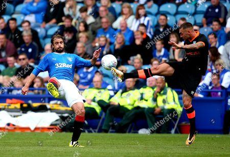 Stock Image of Jack Hunt of Sheffield Wednesday beats Niko Kranjcar of Rangers to the ball