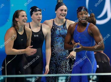 Stock Picture of United States' Kathleen Baker, Lilly King, Kelsi Worrell and Simone Manuel, from left, celebrate after setting a new world record in the women's 4x100-meter medley relay during the swimming competitions of the World Aquatics Championships in Budapest, Hungary