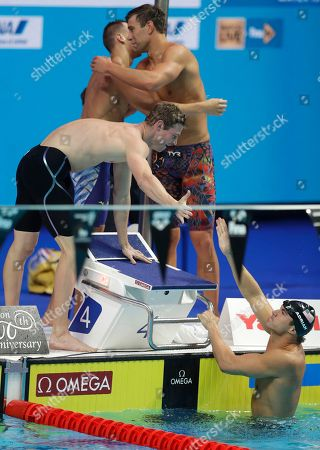 United States' Kevin Cordes, Caeleb Dressel, Matt Grevers, top from left, and Nathan Adrian, bottom, celebrate after winning the gold medal in the men's 4x100-meter medley relay final during the swimming competitions of the World Aquatics Championships in Budapest, Hungary