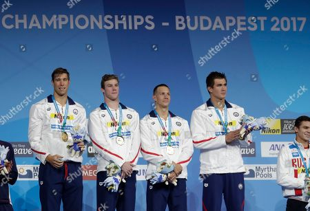United States' gold medal winners Matt Grevers, Kevin Cordes, Caeleb Dressel and Nathan Adrian and Matt Grevers, from left, attend the ceremony for the men's 4x100-meter medley relay final during the swimming competitions of the World Aquatics Championships in Budapest, Hungary