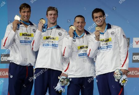 Stock Image of United States' gold medal winners Matt Grevers, Kevin Cordes, Caeleb Dressel and Nathan Adrian and Matt Grevers, from left, show off their medals during the ceremony for the men's 4x100-meter medley relay final during the swimming competitions of the World Aquatics Championships in Budapest, Hungary