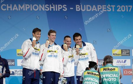 Stock Picture of United States' gold medal winners Matt Grevers, Kevin Cordes, Caeleb Dressel and Nathan Adrian, from left, show off their medals during the ceremony for the men's 4x100-meter medley relay final during the swimming competitions of the World Aquatics Championships in Budapest, Hungary