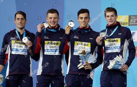 Britain's silver medal winners Chris Walker-Hebburn, Adam Peaty, James Guy and Duncan Scott, from left, attend during the ceremony for the men's 4x100-meter medley relay final during the swimming competitions of the World Aquatics Championships in Budapest, Hungary