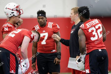 Stock Photo of Pernell Jefferson, Trent Bray, Dedrick Young II, Luke Gifford, Mohamed Barry Linebackers coach Trent Bray talks to Nebraska linebackers from left: Dedrick Young II, Luke Gifford (12), Mohamed Barry (7) and Pernell Jefferson (32), on the first day of NCAA college football preseason practice, in Lincoln, Neb