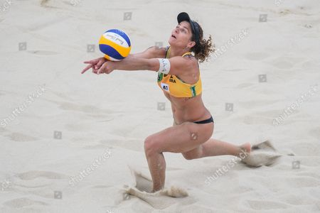 Larissa Franca Maestrini of Brazil in action during the first round match against Emily Day and Nicole Branagh of the US of the Beach Volleyball World Championships 2017 at the Danube Island (Donauinsel) in Vienna, Austria, 30 July 2017.