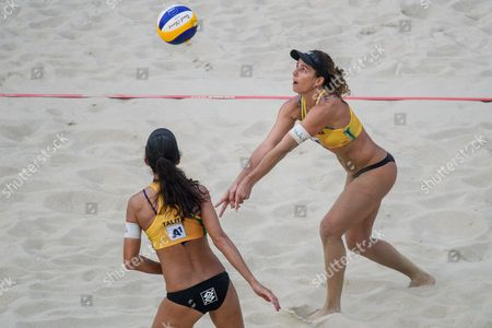 Stock Image of Larissa Franca Maestrini (R) and Talita Da Rocha Antunes (L) of Brazil in action during the first round match against Emily Day and Nicole Branagh of the US of the Beach Volleyball World Championships 2017 at the Danube Island (Donauinsel) in Vienna, Austria, 30 July 2017.