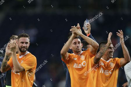 FC Porto's Miguel Layun (L) Hector Herrera (C) and Maxi Rodriguez greet their fans after winning a friendly soccer match against Deportivo de la Coruna held at Dragao stadium, Porto, Portugal, 30 July 2017.