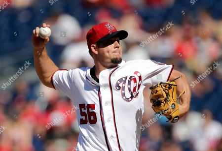 Washington Nationals relief pitcher Joe Blanton pitches during a baseball game between the Colorado Rockies and Washington Nationals, in Washington