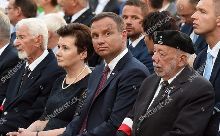 President of Poland Andrzej Duda (2-R) and President of Warsaw Hanna Gronkiewicz-Waltz (2-L) during the Holy Mass in front of the Warsaw Uprising Monument on pl. Krasinskich in Warsaw, Poland, 31 July 2017. This is in commemoration the 73rd anniversary of the outbreak of the Warsaw Uprising.