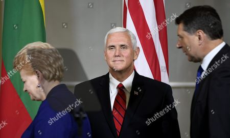 Stock Picture of The President of Latvia Raimond Vejonis (R), the President of Lithuania Dalia Grybauskaite and The Vice President of the United States Mike Pence (C) during their joint press conference in Tallinn