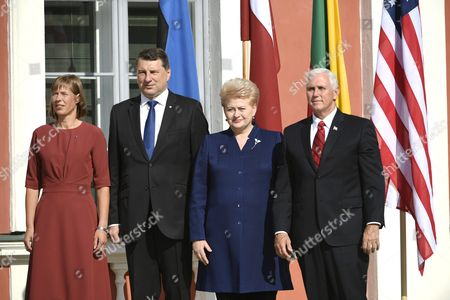President of Estonia Kersti Kaljulaid (L), the President of Latvia Raimond Vejonis, the President of Lithuania Dalia Grybauskaite and The Vice President of the United States Mike Pence (R) pose for an official photo in Tallinn
