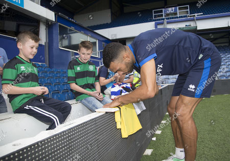 Steven Caulker signs autographs for the fans at the QPR open training session at their Loftus Road Stadium prior to the start of the new season