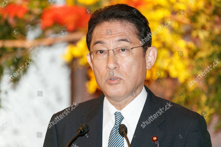 Japanese Minister for Foreign Affairs and Minister of Defense Fumio Kishida speaks during a news conference at the Iikura guest house